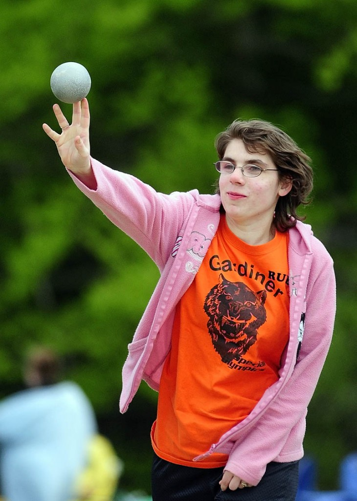 Gardiner athlete Ruby Fowler puts the shot during the Kennebec Area Special Olympics Games on Tuesday at Hall-Dale High School in Farmingdale.