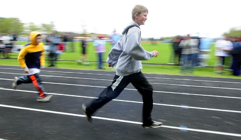 Benjamin Perkins, an independent from Maranacook, center, runs the 100-meter dash during the Kennebec Area Special Olympics Games on Tuesday at Hall-Dale High School in Farmingdale. There were 275 athletes competing in running, jumping and throwing events in the annual meet. About 45 students from Hall-Dale's Jobs For Maine's Graduates program helped to run the event.