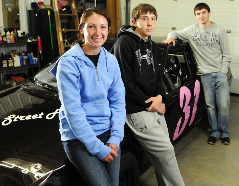FAMILY BUSINESS: Leandra Martin, left, joined her cousins Cody, center, and Nate Tribbet as race car drivers at Wiscasset Speedway. Martin is driving a car in the Thunder 4