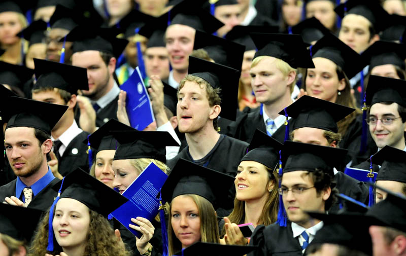 Colby College graduates cheer and whistle during Senior Class speaker Michael Langley's speech during commencement in Waterville on Sunday.