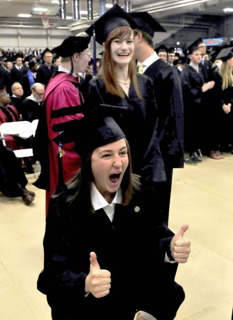 Colby College student Danielle Dellarco gives thumbs-up to family members as she and other graduates received their diplomas during commencement in Waterville on Sunday.