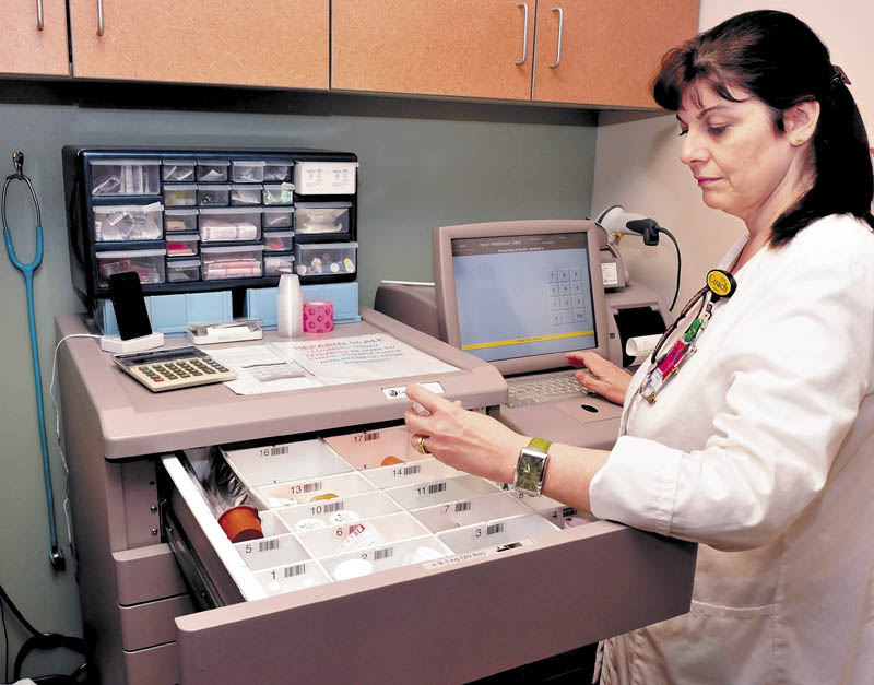 Inland Hospital nurse Hope Pendexter uses a Computerized Provider Order Entry system that ensures that physician prescribed medications, ordered through a computer system, gets to the correct patient at the Waterville hospital on Wednesday.