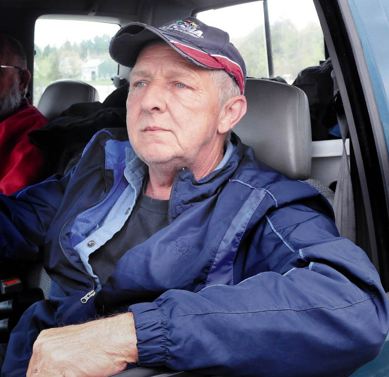 John Spencer Sr., father of missing snowmobiler John Spencer Jr., speaks about the loss of his son and the ongoing effort to retrieve his body from Rangeley Lake on Tuesday.