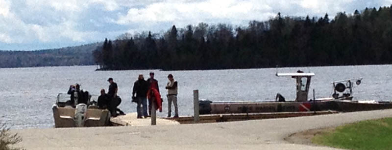 Maine Warden Service divers searched Rangeley Lake on Thursday for three snowmobilers missing since winter.