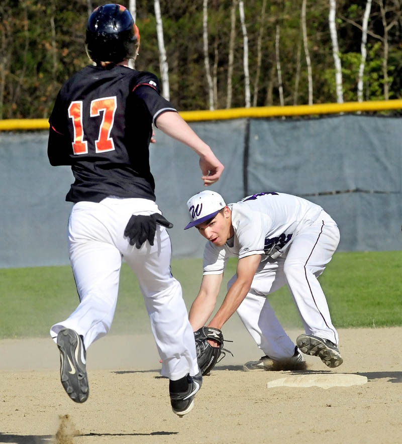 THAT'S AN OUT: Waterville's Tyler Bouchard scoops the ball and tags second base to force out Winslow's Alex Berard on Monday in Winslow.
