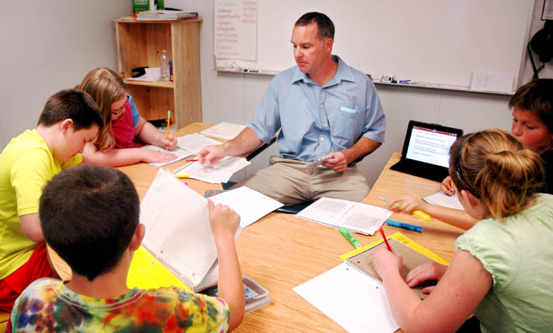 Fifth-grade teacher Michael Louder works in a small group with students at Canaan Elementary School during a reading workshop Friday. The school was one of two in Skowhegan-based School Administrative District 54 that Department of Education Commissioner Stephen Bowen visited that day.