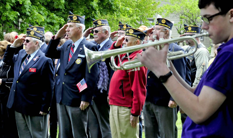 REMEMBER: Waterville American Legion Post 5 members from front left are Ernie Paradis, Gilman Pelletier and Tom Longstaff, salute during Memorial Day celebration at Veteran's Park as Liam Edwards plays Taps on Monday, May 27, 2013