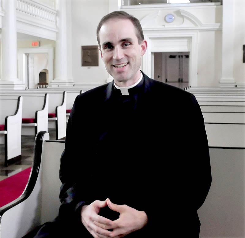 The Rev. Jack Dickinson sits in a pew in Lorimer Chapel at Colby College in Waterville on Sunday. Dickinson will be relocating to the Good Shepherd Parish in the Saco and Biddeford area, effective Aug. 1.