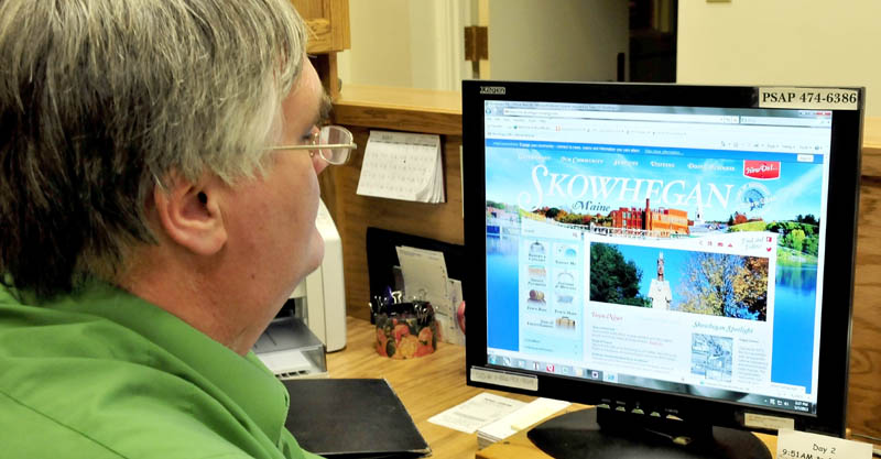Jeff Hewett, director of Skowhegan Economic and Community Development, looks over the new interactive town website on Tuesday.