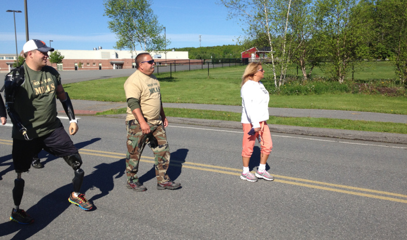 Staff Sgt. Travis Mills, left, walks during the second annual Miles for Mills 5K fundraiser on Monday, in Augusta.