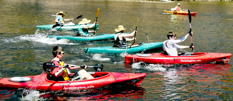 Some of the 40 kayaks, canoes and paddlers take off in the start of a 10-mile trip from Strong to Fairbanks, during the University of Maine at Farmington Mainely Outdoors Program's third annual Cinco de Mayo Canoe Race & Fun Paddle on Sunday.