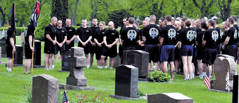 Cadets from the Maine Criminal Justice Academy ran from the Vassalboro facility to St. Francis Catholic Cemetery in Waterville on Thursday during the Fallen Law Enforcement Officers run. Once there, the 42 cadets paid tribute to Trooper Jeffrey Parola who died in 1994 while responding to a call involving firearms in Sidney.