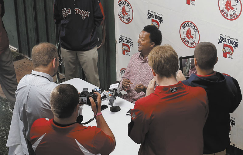 STAR IN TOWN: Former Red Sox pitcher Pedro Martinez, now special assistant to the general manager, fields questions at a press conference Wednesday at Hadlock Field in Portland. Martinez was in town to work with the Sea Dogs' pitching staff.