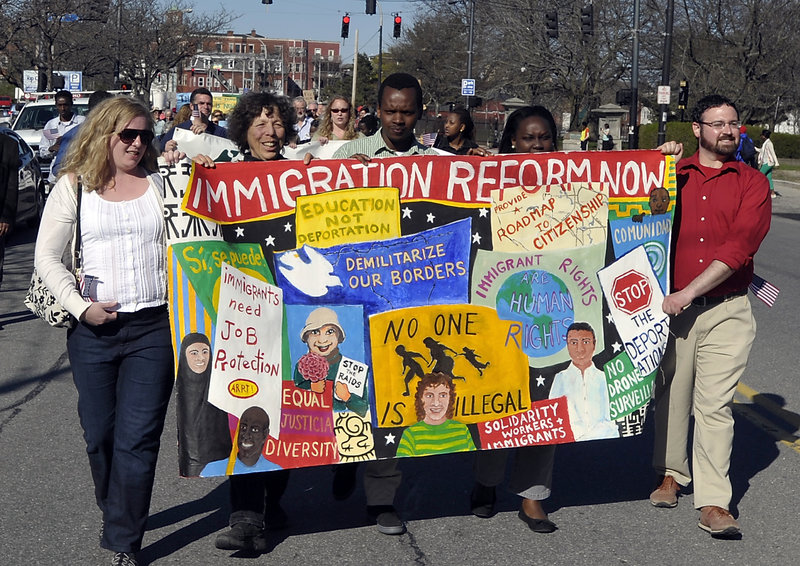 A variety of groups in Portland marched in support of immigration reform from Lincoln Park to Monument Square on Wednesday, May 01, 2013. This banner was made by the Artist Rapid Response Team!, part of the Union of Maine Visual Artists who regulary paint banners for groups whose mission they support.