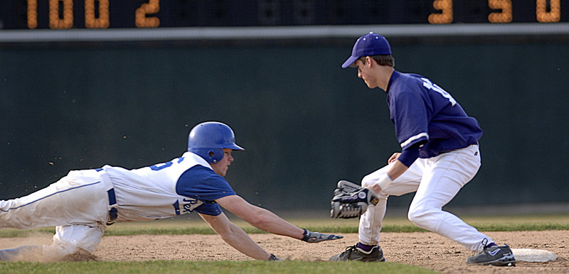 In high school action at Hadlock Field in 2007, James Nutter dives for second as short stop Matt Powers catches a pickoff throw.