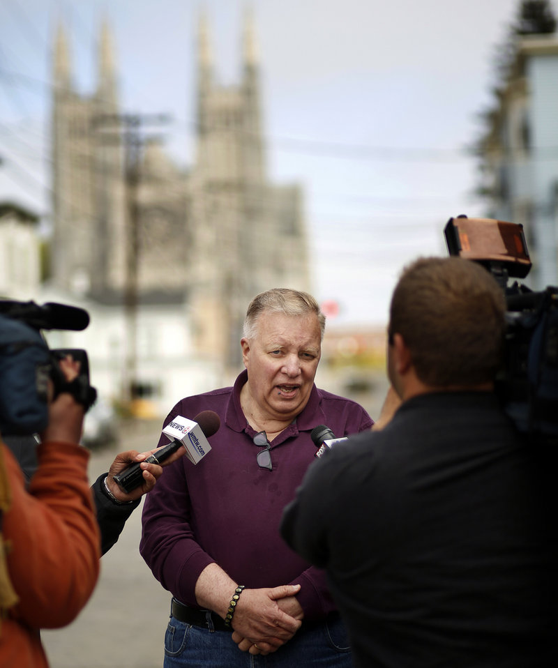 Lewiston Mayor Robert Macdonald talks to the media Tuesday on Bartlett Street. Local residents and businesses have helped fire victims by donating volunteer time and goods.