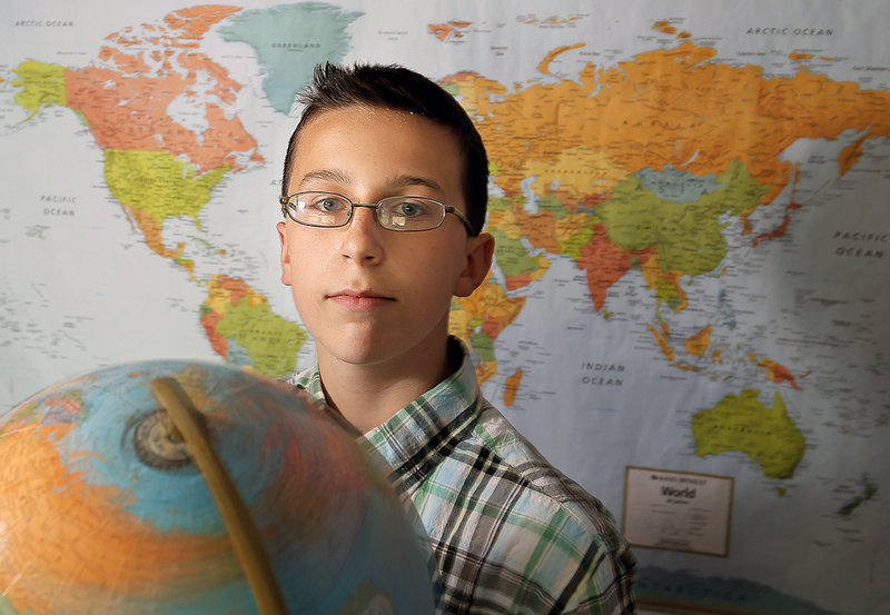 Archer Thomas, 13, an eighth grader at Bonny Eagle Middle School, poses for a portrait in his Buxton home Friday, May 17, 2013. Thomas will be competing next week in the National Geographic Bee in Washington, D.C.