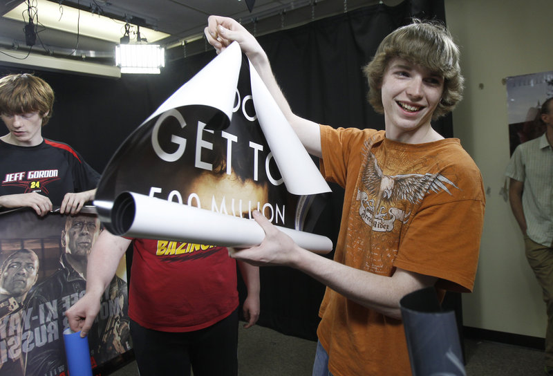 In this Thursday, May 16, 2013 photo, A.J. Swan holds a movie poster during class in Randolph, Vt. Failing 9th grade for the second year in row, Swan said he had accepted that he wasn't going to graduate from high school. That was until the school stepped in and offered him some alternative ways to prove his competencies and a hands-on learning environment at a technical school where he has thrived in video. (AP Photo/Toby Talbot)