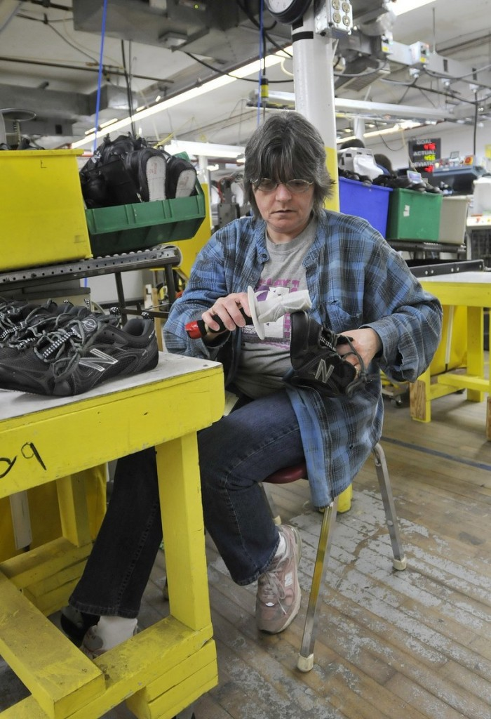 Debbie Foss washes shoes at the New Balance factory in Norridgewock. New Balance is one of the last remaining sneaker makers in the U.S.