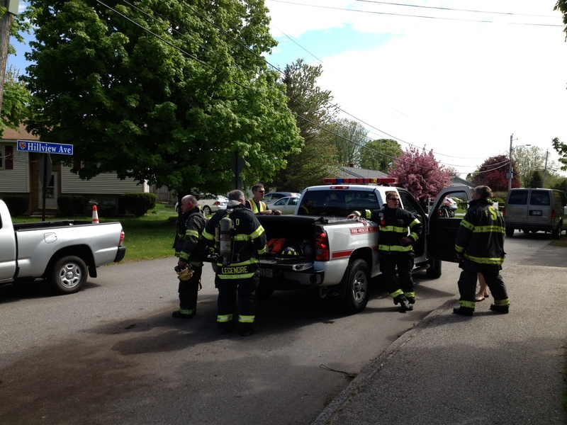 Firefighters block a section of Hillview Avenue in Saco on Saturday during a standoff.