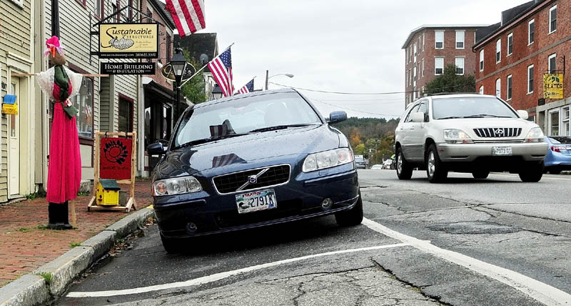 Some of the parking spots on the Kennebec River side of Water Street in downtown Hallowell tilt down toward the sidewalk. Local and state officials on Wednesday will discuss the early findings of a Water Street reconstruction feasibility study, and are expected to answer questions.