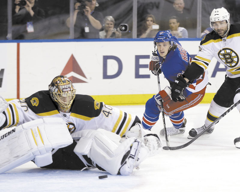 WHOOPS: New York 's Carl Hagelin, center, watches as his shot gets past Boston goalie Tuukka Rask during the second period of the Rangers' 4-3 win in Game 4 of the Eastern Conference semifinals Thursday in New York.