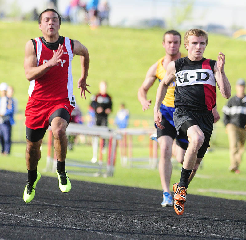 OFF TO THE RACES: Cony's Luke Dang, left, and Hall-Dale's Tyler Fitzgerald run the 100-meter dash during the Cony Under the Lights meet on Friday in Augusta.