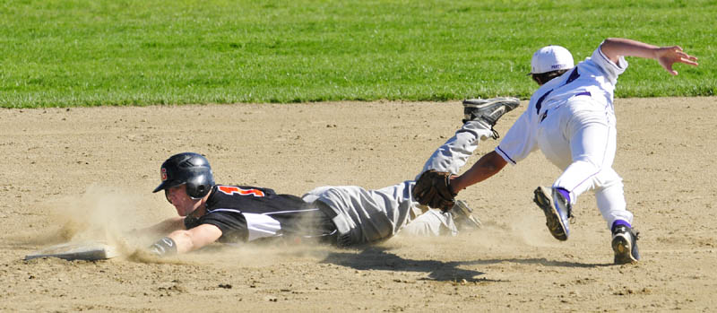SAFE: Gardiner's Frank Chepke slides safely into second base away from a tag by Waterville second baseman Cam Gardiner during Friday's game in Gardiner.