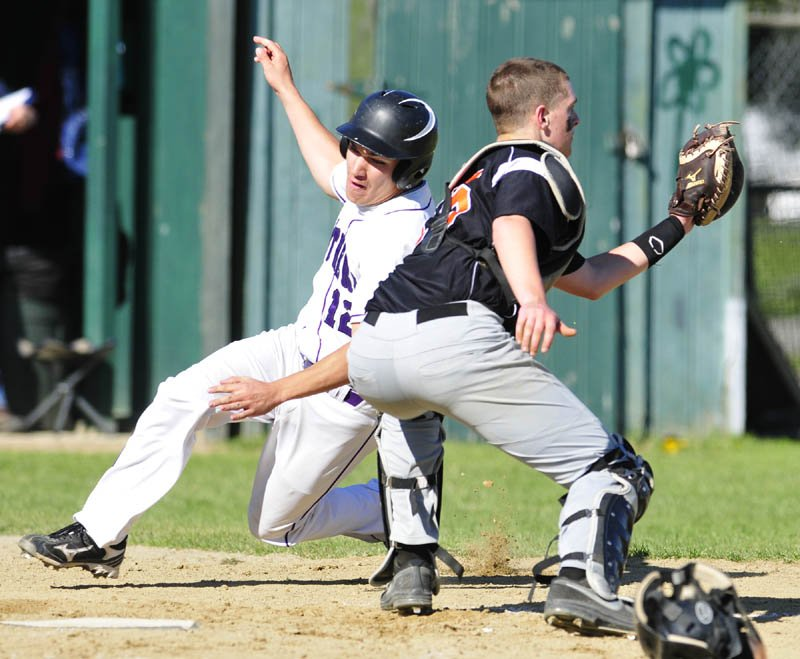 EXCUSE ME: Waterville Tyler Bouchard, left, gets around Gardiner catcher Jensen Orewiler during a game on Friday in Gardiner. He scored on a double by Aiden FitzGerald. Waterville won the game 12-1.