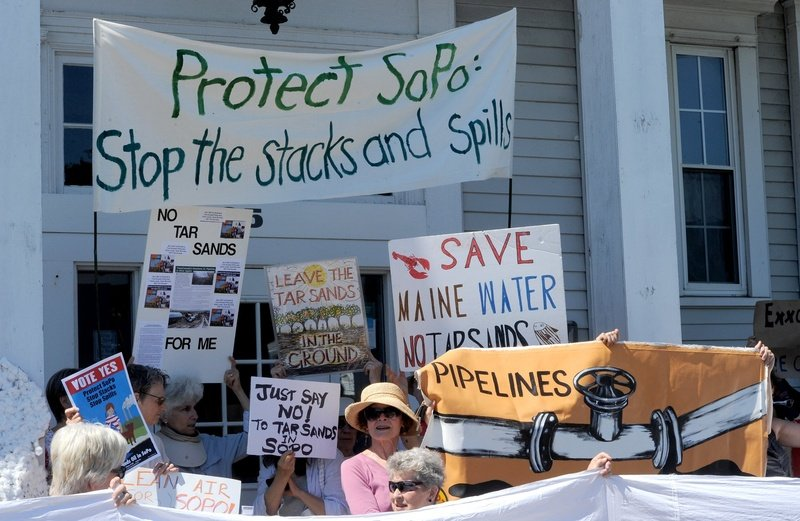 Members and supporters of Concerned Citizens of South Portland hold a news conference outside South Portland City Hall on Monday. TarSands