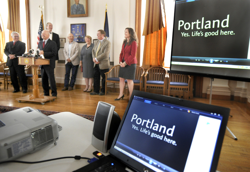 "Portland Mayor Michael Brennan speaks during the unveiling of the city's new slogan, ""Portland, Maine. Yes. Life's good here,"" during a news conference at Portland City Hall on Tuesday. Slogan"