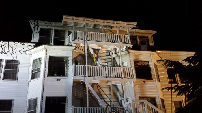 Hoses extend up the staircase to the rear apartments at 26 Sewall St. in Augusta late Saturday. Fire appeared to have damaged the top-floor apartment at the rear of the building. A cause was not immediately available, and it was unknown late Saturday if the fire caused any injuries.