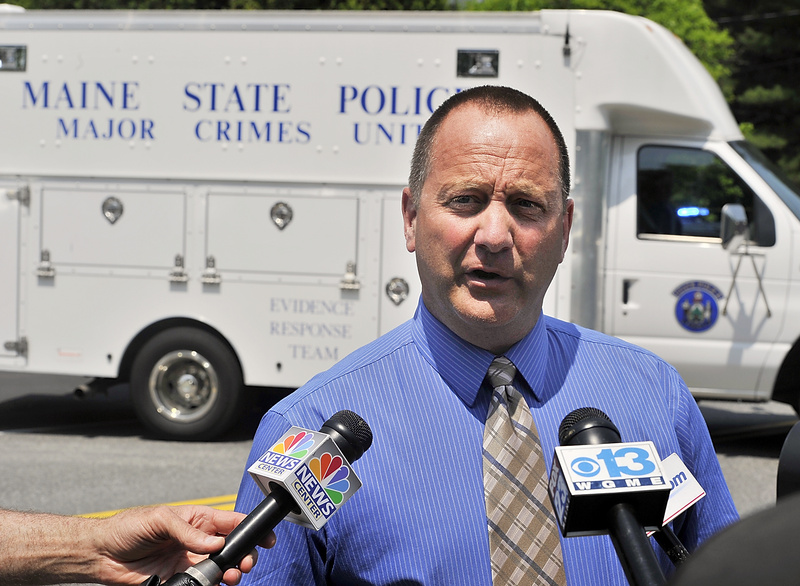 Maine State Police Sgt. Chris Harriman updates the media after a family member found a father and son dead in an apparent murder-suicide in Freeport on Tuesday.