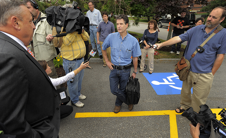 Dean Kamen, center, inventor of the Segway PT, speaks with Gov. Paul LePage, far left, as the media gather outside Fairchild Semiconductor in South Portland Thursday.