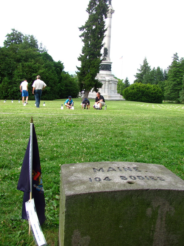 Soldiers' National Cemetery holds the remains of 104 Maine soldiers who died during the Battle of Gettysburg in July 1863. In the background, Ken Quinn and his sons, Adrian and Sean, of Lisbon Falls pause to read placards placed at the graves of some of the Maine soldiers.