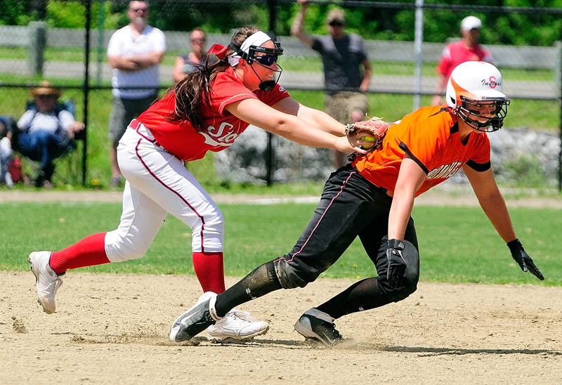 Scarborough third baseman Erin Giles, left, tags out Skowhegan baserunner Shelly Obert after she got caught in rundown between third and second during Class A softball state championship Saturday at Cony Family Field in Augusta.