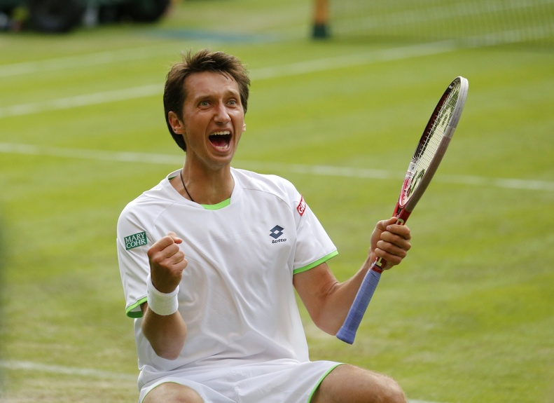 Sergiy Stakhovsky of Ukraine reacts as he wins against Roger Federer of Switzerland in their men's second-round singles match at Wimbledon in London on Wednesday.