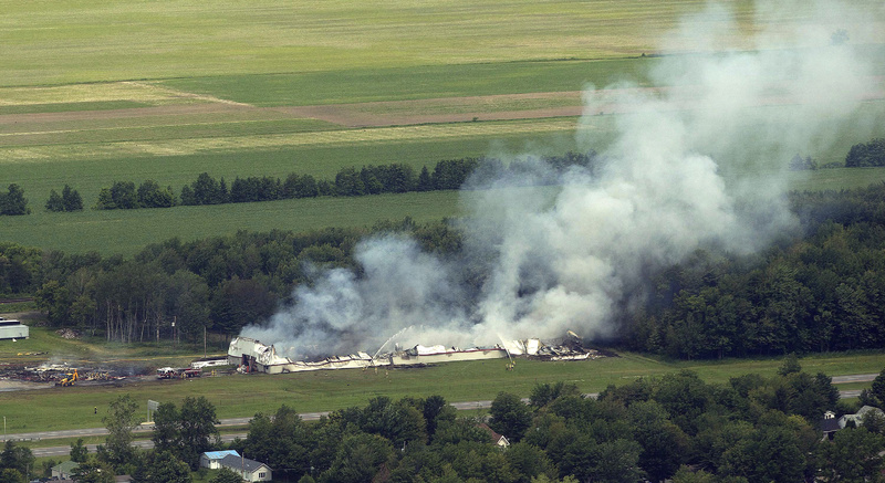 Smoke billows from the B.E.M fireworks factory in Coteau du Lac, Quebec, on Thursday following an explosion. Canada;Quebec;Montreal;BEM;Fireworks;fire;explosion;danger