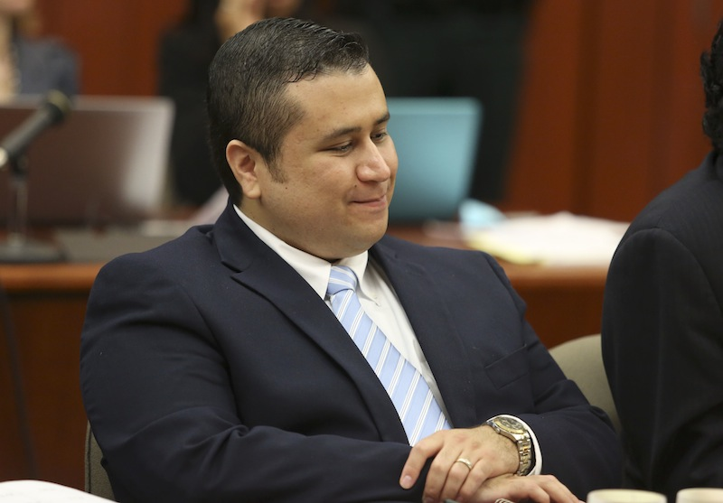 George Zimmerman smiles as attorney Mark O'Mara questions potential jurors for Zimmerman's trial in Seminole circuit court in Sanford, Fla., Thursday, June 20, 2013. Zimmerman has been charged with second-degree murder for the 2012 shooting death of Trayvon Martin. (AP Photo/Orlando Sentinel, Gary Green, Pool)