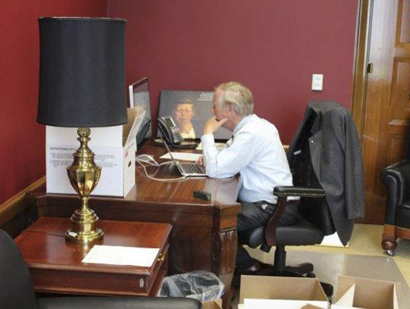 Sen. Angus King, I-Maine, is surrounded surrounded by boxes Tuesday as he sits at his desk in his new, permanent office in the Dirksen Senate Office Building in Washington, D.C. The same desk has been used by a lineage of Maine senators, including King's predecessor Sen. Olympia Snowe, Sen. George Mitchell and Sen. Edmund Muskie.