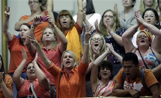 Members of the gallery cheer and chant as the Texas Senate tries to bring an abortion bill to a vote as time expires on Wednesday in Austin, Texas.