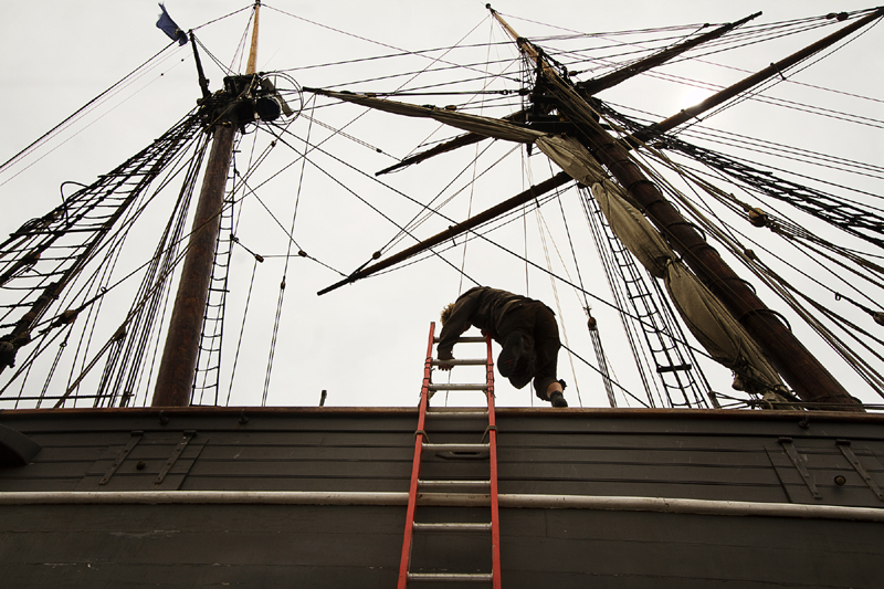A crew member climbs aboard the replica of the former slave ship Amistad on Thursday, which is in dry dock at Gowen Marine in Portland.