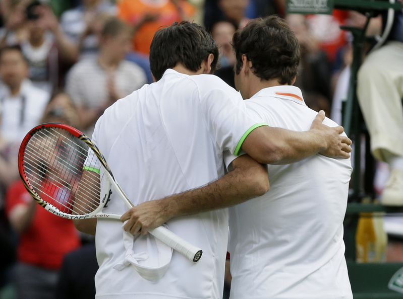 Sergiy Stakhovsky of Ukraine, left, speaks with Roger Federer of Switzerland after he defeated him in their men's second-round singles match at Wimbledon in London on Wednesday.