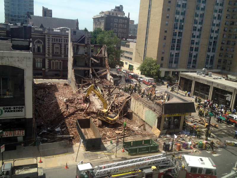 Emergency personnel respond to a building collapse in downtown Philadelphia on Wednesday, where the city fire commissioner said as many as eight to 10 people are believed trapped in the rubble.
