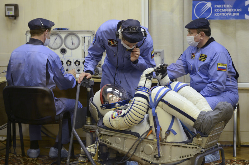 In this picture taken through a safety glass, U.S. astronaut Christopher Cassidy of York, Maine, crew member of the mission to the International Space Station (ISS), is seen during inspection of his space suit prior to the launch of Soyuz-FG rocket at the Russian leased Baikonur Cosmodrome in Kazakhstan on Thursday, March 28, 2013. (AP Photo/Ramil Sitdikov, Pool)