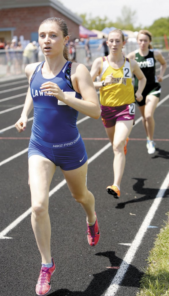 ON THE WAY TO VICTORY: Lawrence High School's Erzsie Nagy makes her way to the finish line in the 1,600-meter run at the Class A state championships track and field meet Saturday in Brewer. Nagy won the race in a time of 5 minutes, 1.07 seconds. She also won the 800 and the 3,200 to help the Bulldogs finish fourth.