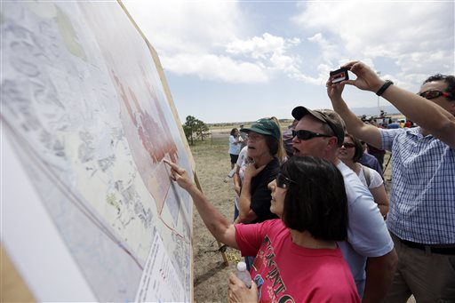 Residents look at a map of the Black Forest Fire after a press briefing in Colorado Springs, Colo., on Saturday.