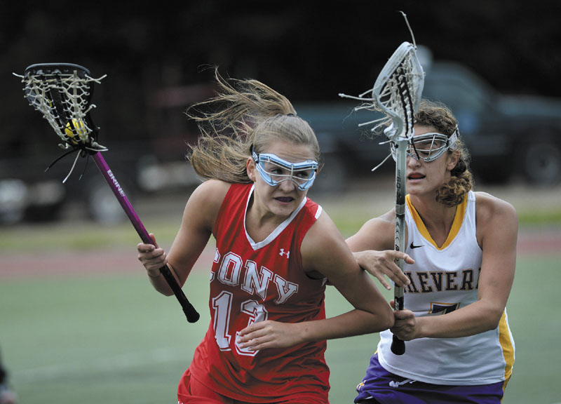 ON THE MOVE: Cony's Hayley Quirion takes off down field as Elyse Caiazzo of Cheverus moves in on defense during the Stags' 16-6 win in the Eastern Maine Class A regional final Wednesday at Fitzpatrick Stadium in Portland.