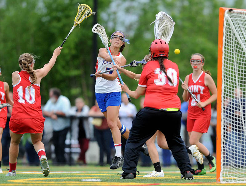 Messalonskee High School's Kristyna Bernatchez, 7, center, takes a shot on Cony High School goalie Isabelle Eames, 30, in the second half of the Eastern A semifinals game at Thomas College in Waterville on Saturday. Cony defeated Messalonskee 13-10.