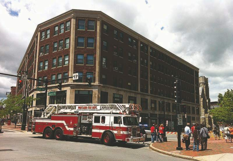 A one-block section of High Street between Congress and Deering streets will remain closed until at least noon Monday after the brick facade on the Congress Building, shown here, began to bow out and separate from the wall.